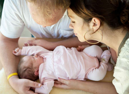 Young couple with their baby girl. Fresh happy family. Stock Photo - 8158220