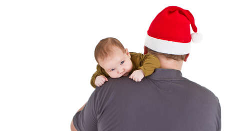 Father with chrismas hat is holding his baby daughter. Isolated over white. photo