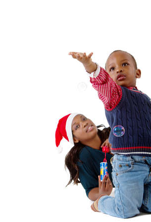 Young baby boy getting ready for christmas with his mother photo