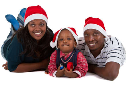 Young black family with a little boy are getting ready for christmas. Happy and cute image. Stock Photo - 8271986