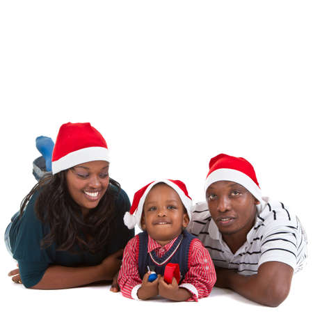 Young black family with a little boy are getting ready for christmas. Happy and cute image. photo