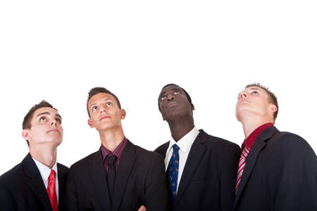 Four young businessmen looking up. Isolated over pure white background. photo