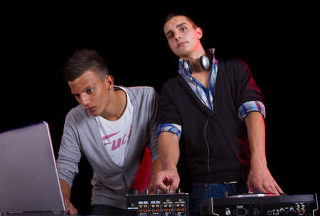 Young people at a party with two young djs.  photo