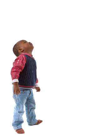 looking over: Young black baby boy looking up. Isolated over white background.