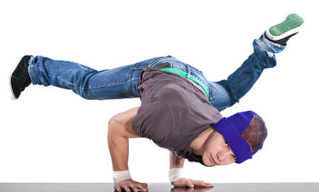 breakdancer: Young handsome fresh man breakdancing with stylish clothes. Stock Photo