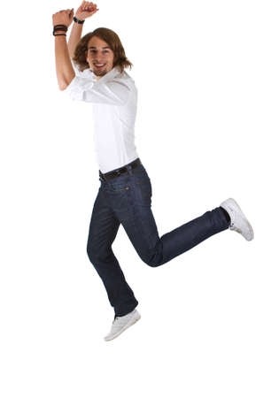 Young happy european man with long hair jumping out of joy Stock Photo - 8548564