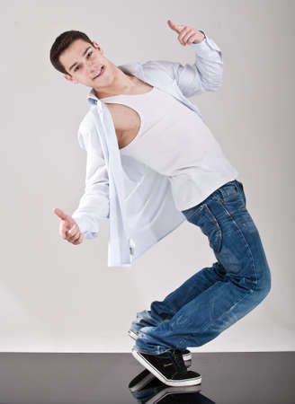 Young handsome fresh man breakdancing with stylish clothes. photo