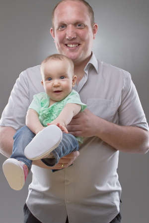 Father with his baby girl. Very cute little toddler with cute shoes. Stock Photo - 9223555