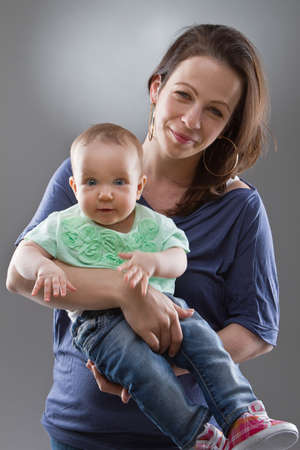 Young mother with her baby girl. Cute image with natural faces. photo