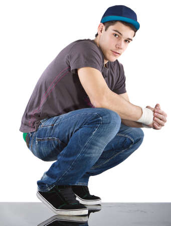 breakdancer: Young man with breakdancing clothes isolated over white background. Stock Photo