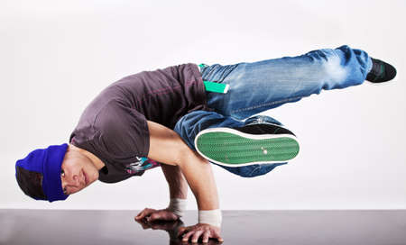 Young handsome fresh man breakdancing with stylish clothes. Stock Photo