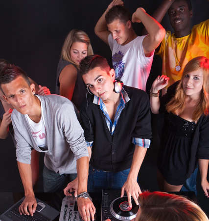 dj party: Young people at a party with two young djs.