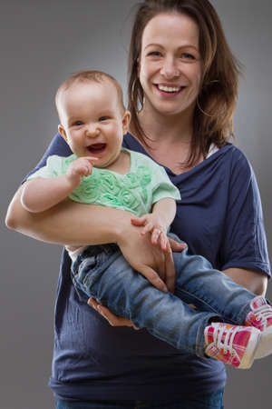 Young mother with her baby girl. Cute image with natural faces. Stock Photo - 9363057