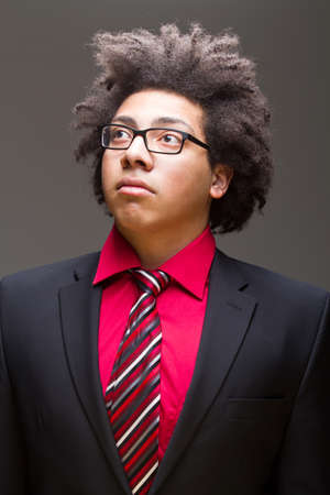 Young afro-american teenager with crazy hair in a business suit. photo