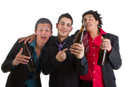 Three young men with business outfit with beer isolated over white. Stock Photo