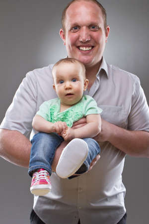 Father with his baby girl. Very cute little toddler with cute shoes. Stock Photo