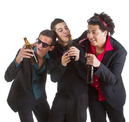 Three young men with business outfit with beer isolated over white. Stock Photo - 9531343