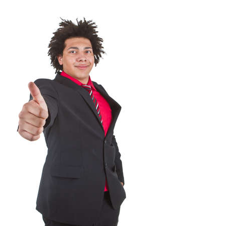 Young afro american businessman with great hair giving a thumbs up sign - isolated over white background. photo
