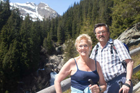 Senior couple hiking in a beautiful alpine setting. Active man and woman. photo