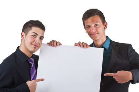 Two young business men presenting a white sign with copyspace. Stock Photo - 9575667
