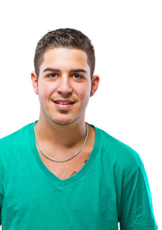 Young man with green t-shirt smiling. Very candid picture. Stock Photo - 9988103