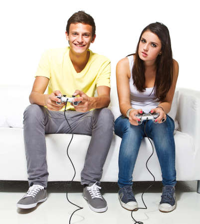 game room: Young couple playing video games. Very candid picture with emotions.