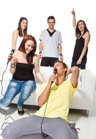 Young teenagers playing a singing video game. Enjoying themselves. Having fun!