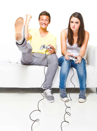 console: Young couple playing video games. Very candid picture with emotions.