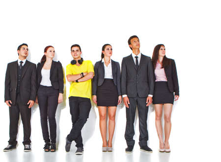 Young group of teenage business people with one young man standing out of the crowd. Stock Photo - 10078167