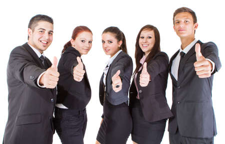 Young group of young business people showing thumbs up signs.  photo