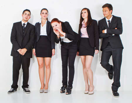 happily: Young girl screaming happily in a group of young business people.
