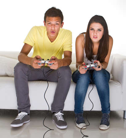 Young couple playing video games. Very candid picture with emotions. photo
