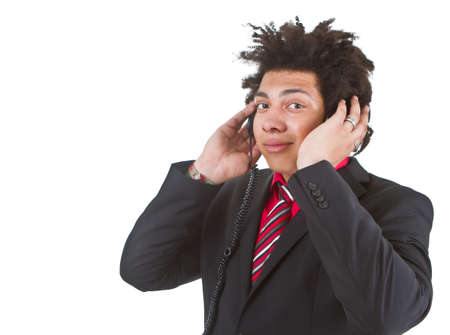 Young afro american business man with headphones listening to music. Isolated over white. photo