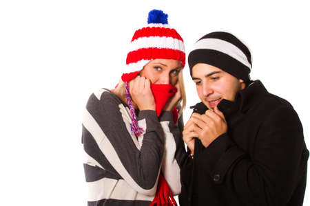 Young couple with winter clothes isolated over white. photo