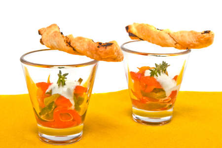 Little fingerfood appetizers in glasses with breadsticks nicely decorated. photo