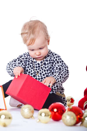 Cute baby girl getting ready for christmas - isolated over white. photo