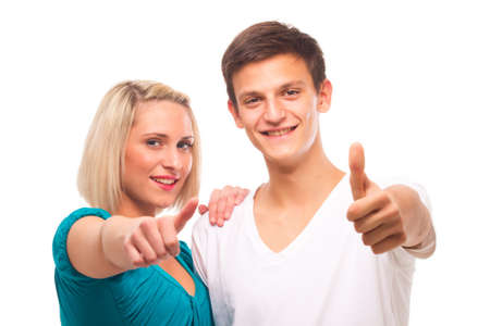 happy couple white background: Young couple isolated over white showing thumbs up sign.