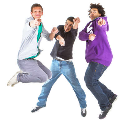 black teens: Three multiracial teenagers jumping over joy over white background. Stock Photo