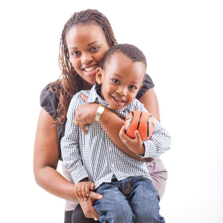 child ball: Young afro american mother with her son isolated over a white background.