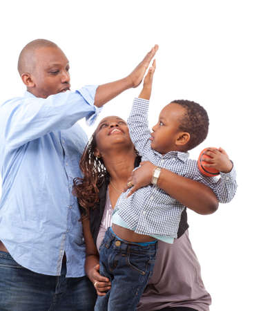 Young happy afro american family isolated over white background. photo
