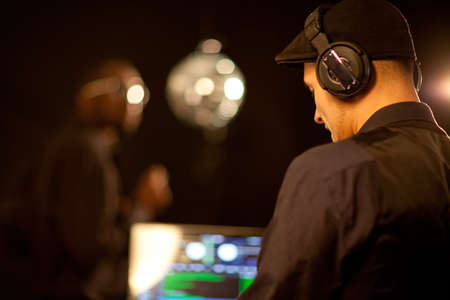 A young phillipino dj working in a club. Stock Photo