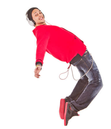 philippino: Young asian man dancing with stylish clothes. Isolated over white.