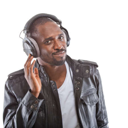 Young black man listening to music over his headphones. photo