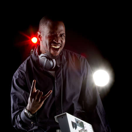 samuel: Young black man with a keyboard and headphones over black background