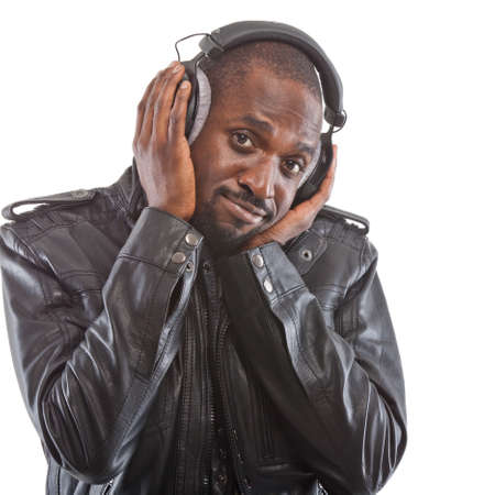 Young black man listening to music over his headphones  photo