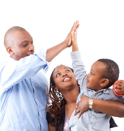 happy black family: Young happy afro american family isolated over white background.