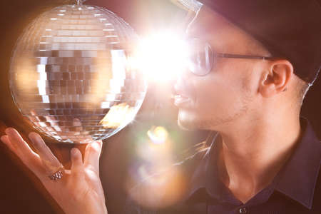 philippino: A young philippino playing with a disco ball