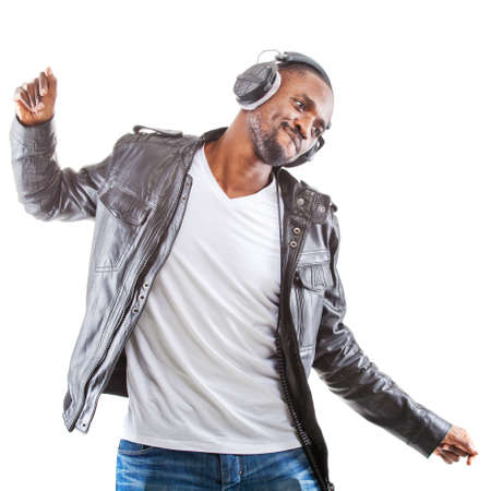 Young black man listening to music over his headphones. Stock Photo - 12683809