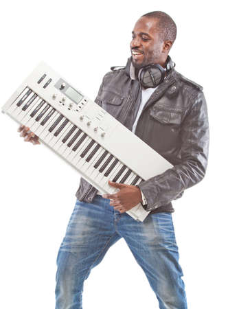 keyboard player: Young black man with headphones and a keyboard. Isolated over white.