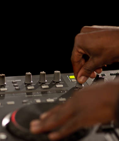 deejay: Hands of a black dj on turntables during a party. Stock Photo